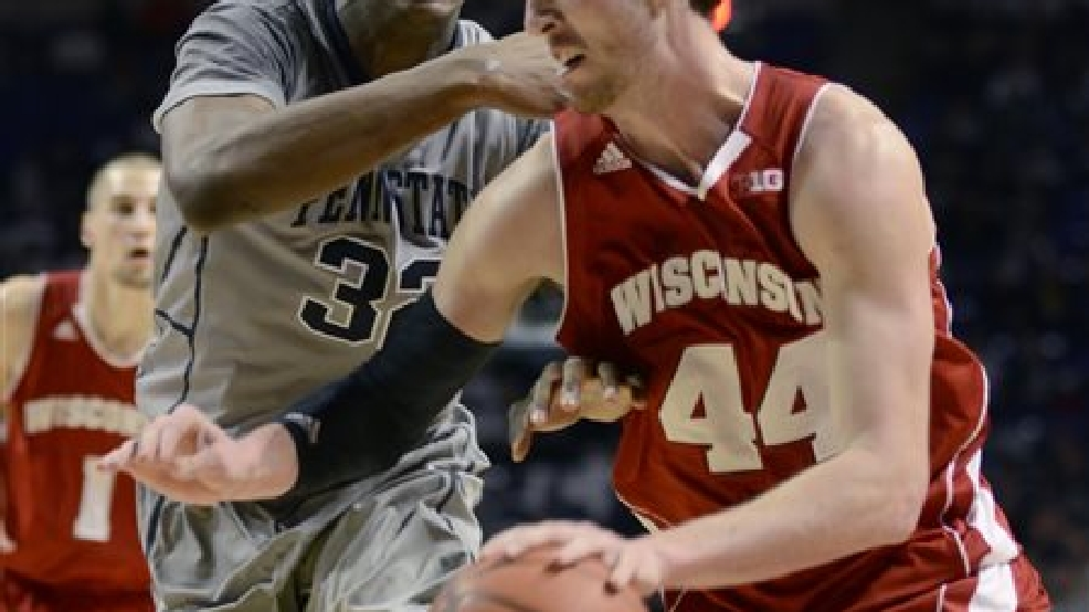 Wisconsin's Frank Kaminsky (44) looks for room around Penn State's Jordan Dickerson (32) during the second half of an NCAA college basketball game Sunday, March 2, 2014 in State College, Pa. Wisconsin won 71- 66. (AP Photo/Ralph Wilson)