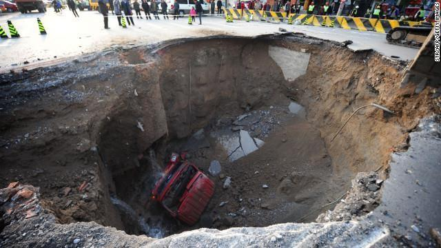 Construction on a subway line caused a huge sinkhole to form in a road in Beijing in April 2011.