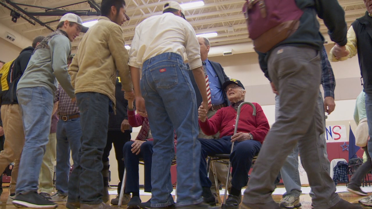 World War II vet Fred Hisaw (in red sweater) meets students and staff at Dayton High School. (KATU)<p></p>
