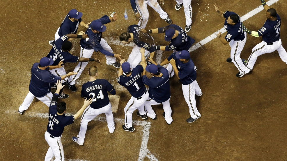 Milwaukee Brewers' Jonathan Lucroy celebrates with teammates after hitting a walk off home run during the ninth inning of a baseball game against the Cincinnati Reds, Tuesday, July 22, 2014, in Milwaukee. The Brewers won 4-3. (AP Photo/Morry Gash)