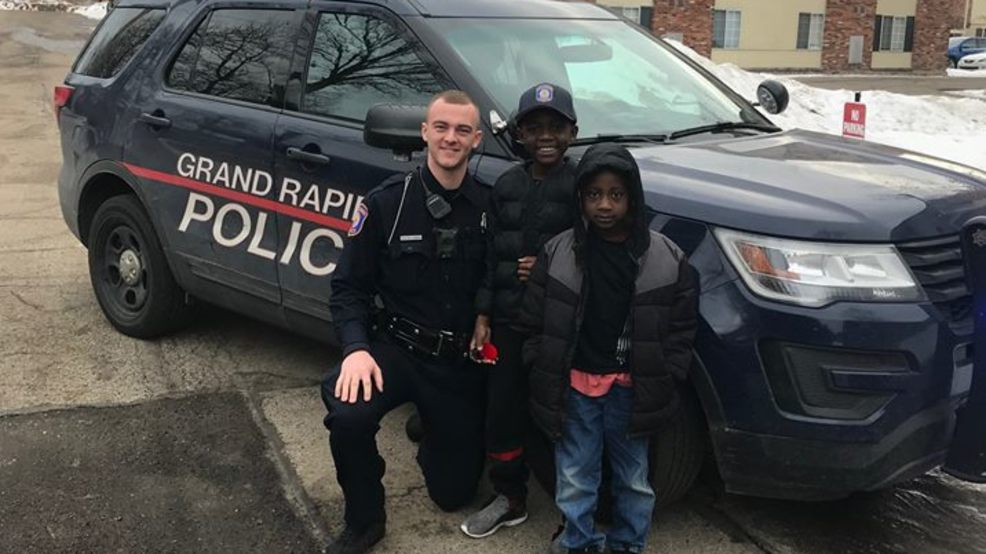 Grand Rapids officers celebrate boys birthday.jpg