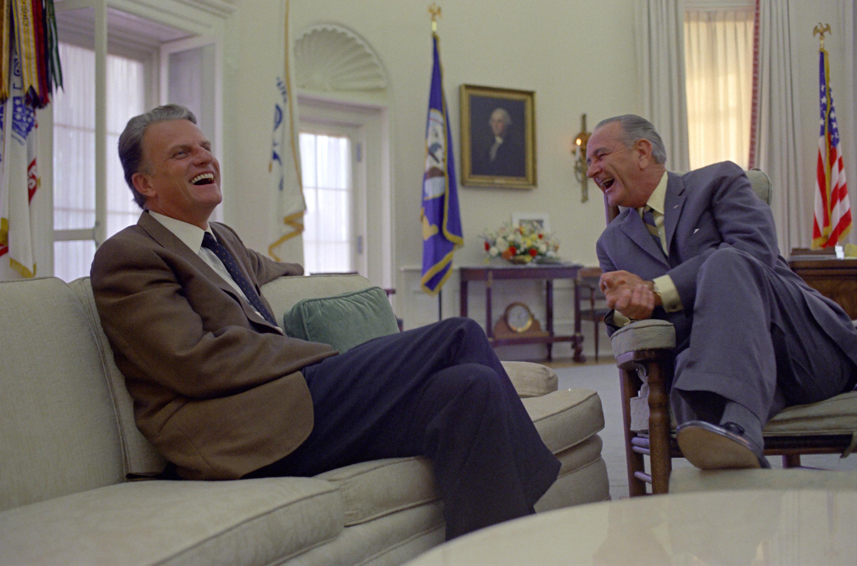 lbj oval office. billy graham and president lyndon b. johnson share a laugh while meeting in lbj oval office