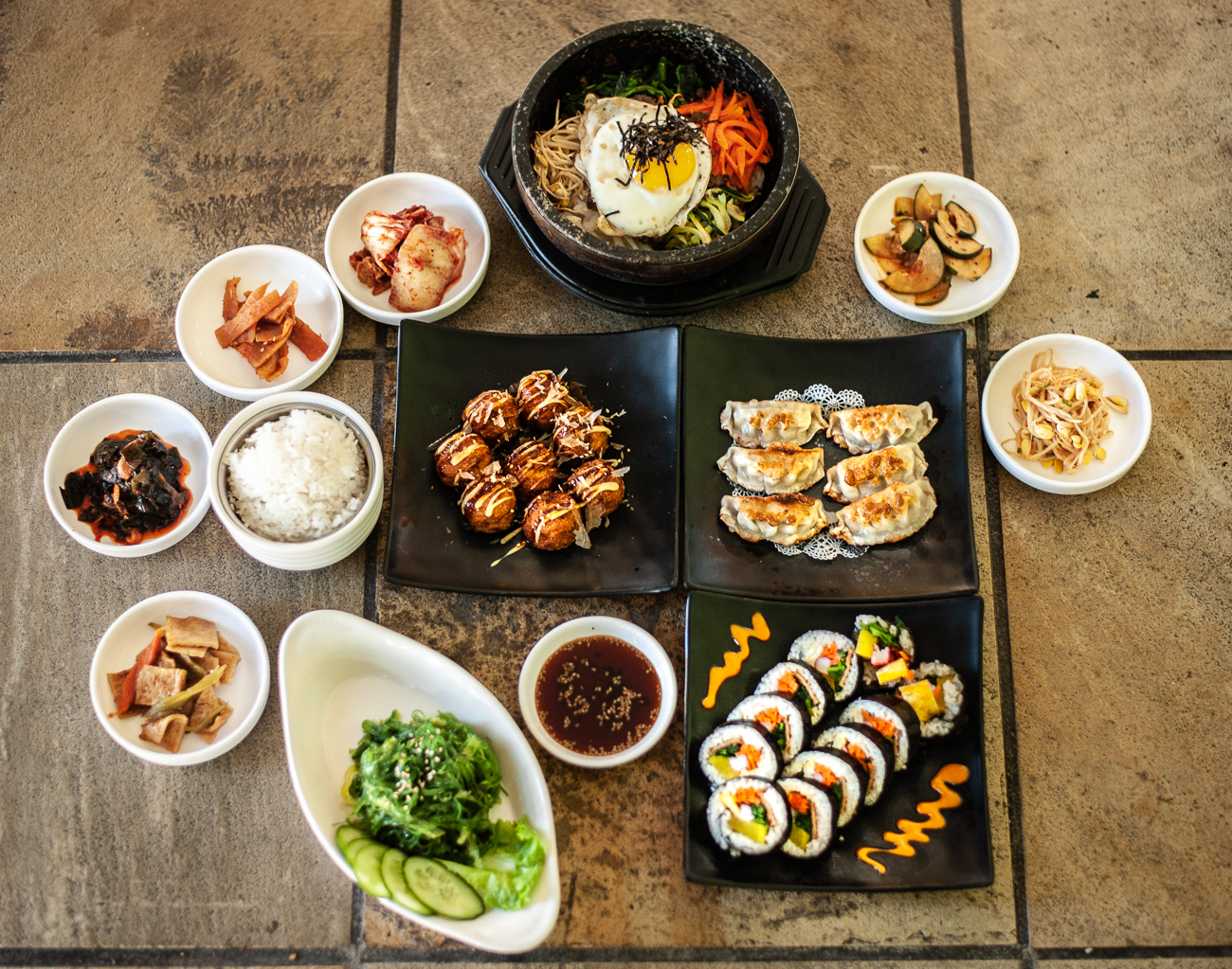 "Korealistic is an authentic Korean restaurant owned and operated by a mother-daughter duo. The eatery specializes in healthy, home-style Korean cooking with a variety of traditional dishes. Situated in a West Chester strip mall, they've been serving patrons since January 2015. Dine-in service is available, or you can call (513) 306-5360 to place an order with curbside pickup. Visit their{&nbsp;}<a  href=""https://www.gokorealistic.com/"" target=""_blank"" title=""https://www.gokorealistic.com/"">website{&nbsp;}</a>to see a full menu of their offerings. ADDRESS: 7735 Cox Lane (45069) / Image: Kellie Coleman // Published: 12.29.20"