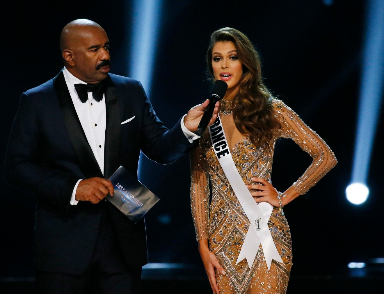 Miss France Iris Mittenaere expounds on her answer during the question-and-answer portion of the Miss Universe 2016 competition Monday, Jan. 30, 2017, at the Mall of Asia in suburban Pasay city, south of Manila, Philippines. Mittenaere won the crown. (AP Photo/Bullit Marquez)