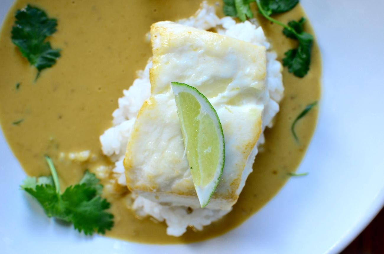 Baked Alaskan halibut with sticky rice, coconut curry, cilantro, and lime / Image: Leah Zipperstein, Cincinnati Refined // Published: 4.28.17
