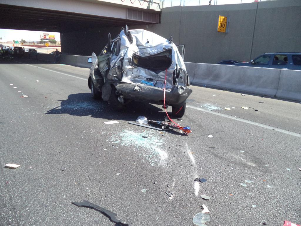 Damage to a 2006 Hyundai Tucson is shown Monday, Sept. 11, 2017, on southbound U.S. 95 near Decatur Boulevard in Las Vegas. (Photo courtesy of Nevada Highway Patrol)