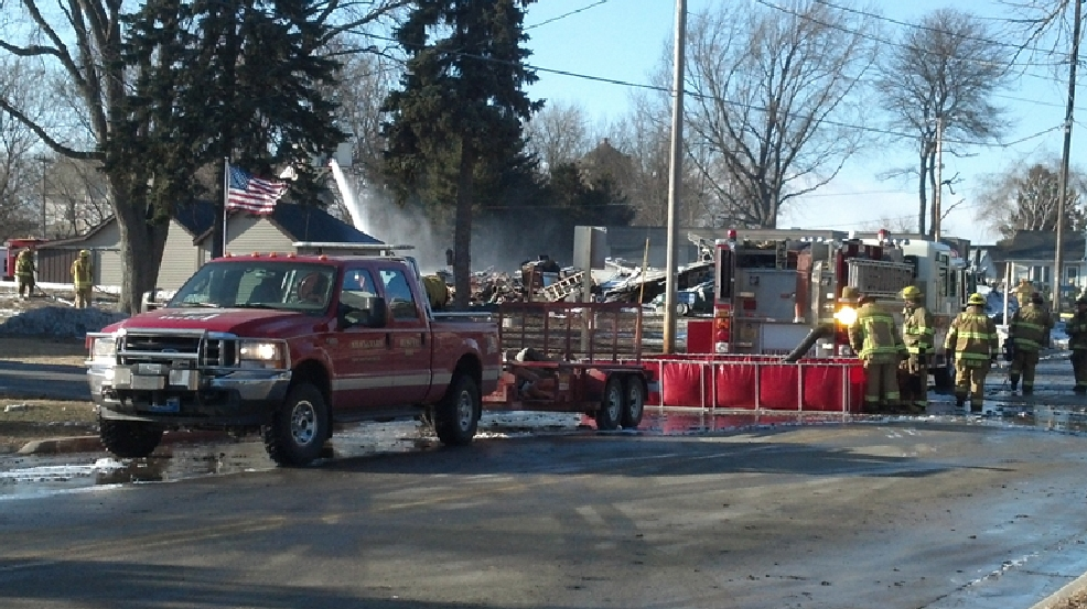 Firefighters on the scene of a fire in the town of Calumet, Tuesday, March 25, 2014. (WLUK/Alex Ronallo)