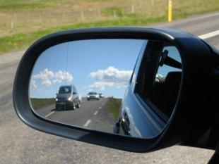 On an aspherical mirror, the main part of the mirror surface is flat, but it curves away toward the outer edge to show all the space in your blind spot.