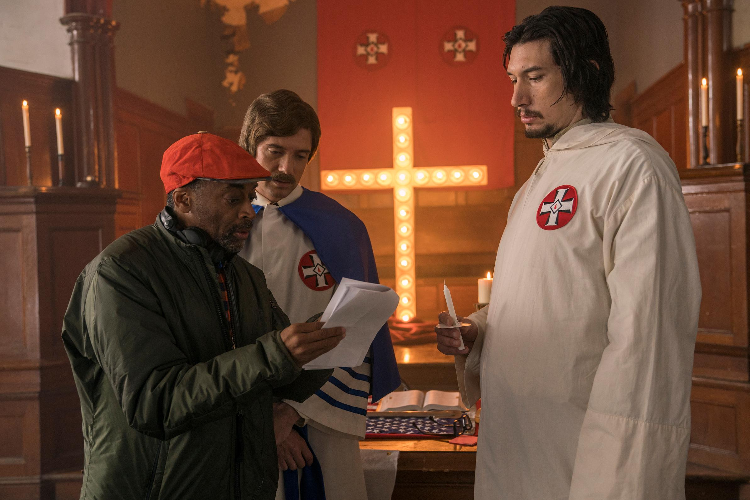 "This image released by Focus Features shows director Spike Lee, left, with actors Topher Grace, center, and Adam Driver on the set of Lee's film ""BlacKkKlansman."" On Tuesday, Jan. 22, 2019, Lee was nominated for an Oscar for best director for his work on the film. The 91st Academy Awards will be held on Feb. 24.  (David Lee/Focus Features via AP)"