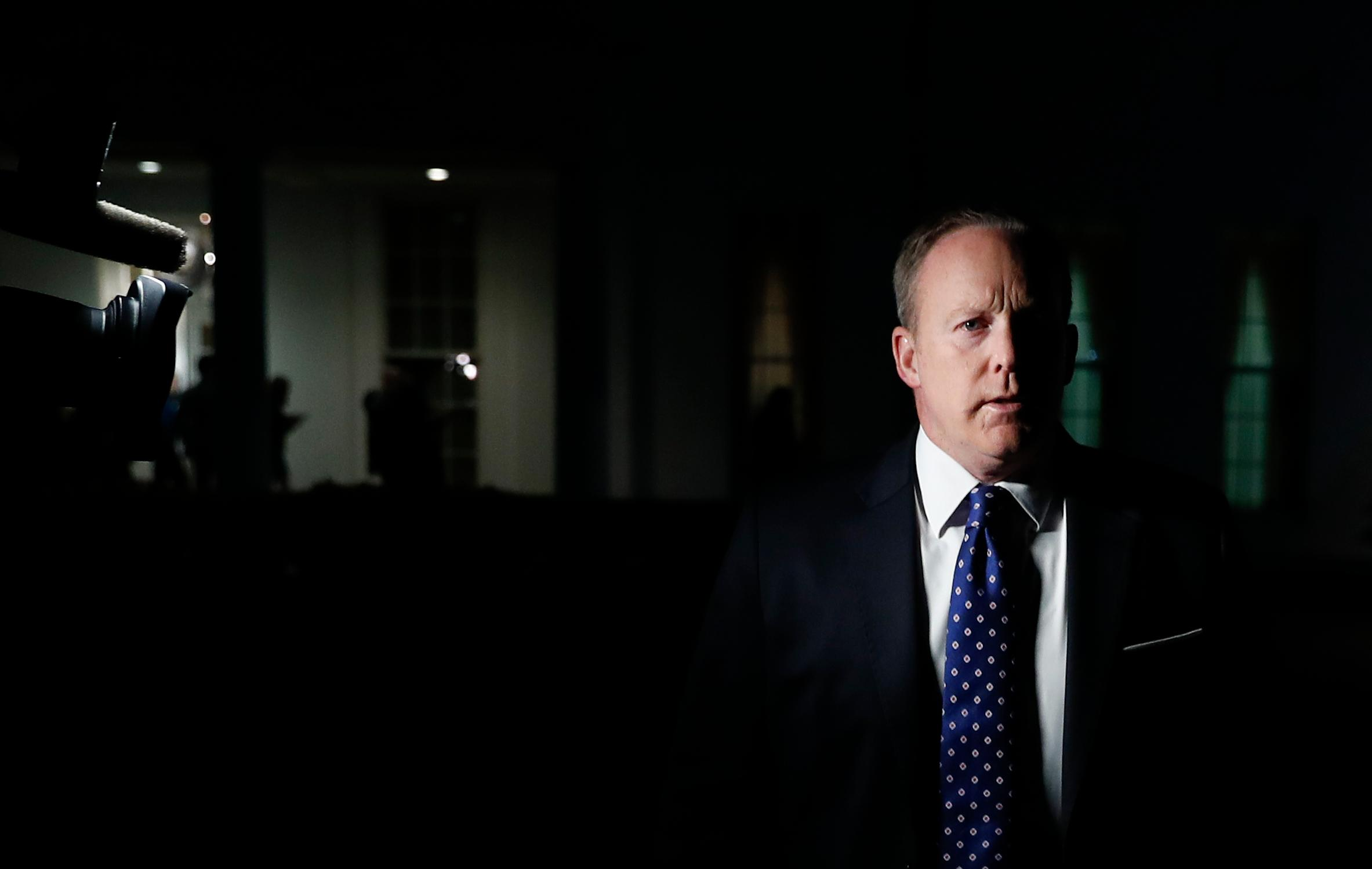 White House press secretary Sean Spicer walks from the West Wing of White House, in Washington, Tuesday, May 9, 2017, to speak to reporters. President Donald Trump abruptly fired FBI Director Comey on May 9, 2017, ousting the nation's top law enforcement official in the midst of an investigation into whether Trump's campaign had ties to Russia's election meddling. (AP Photo/Carolyn Kaster)