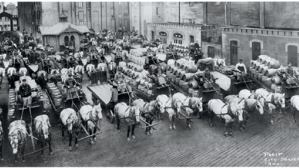This image provided by the Pabst Mansion museum shows beer wagons and horse teams lined up to carry one day's delivery of beer for Milwaukee establishments in 1900. (AP Photo/Pabst Mansion)