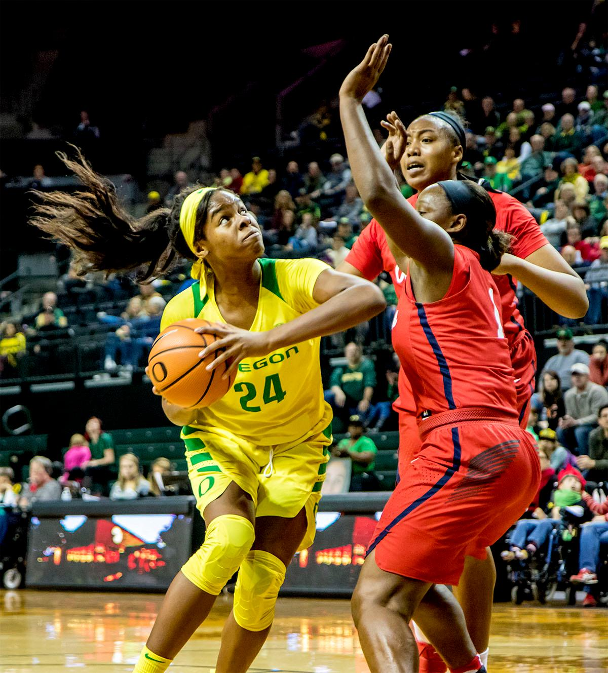 The Duck's Ruthy Hebard (#24) looks for a path to the basket around Rebels players. The Duck's Sabrina Ionescu (#20) is introduced at the start of the game against the Ole Miss Rebels. The Oregon Ducks womens basketball team defeated the Ole Miss Rebels 90-46 on Sunday at Matthew Knight Arena. Sabrina Ionescu tied the NCAA record for triple-doubles, finishing the game with 21 points, 14 assists, and 11 rebounds. Ruthy Hebard added 16 points, Satou Sabally added 12, and both Lexi Bando and Maite Cazorla scored 10 each. The Ducks will next face off against Texas A&M on Thursday Dec. 21 and Hawaii on Friday Dec. 22 in Las Vegas for Duel in the Desert before the start of Pac-12 games. Photo by August Frank, Oregon News Lab