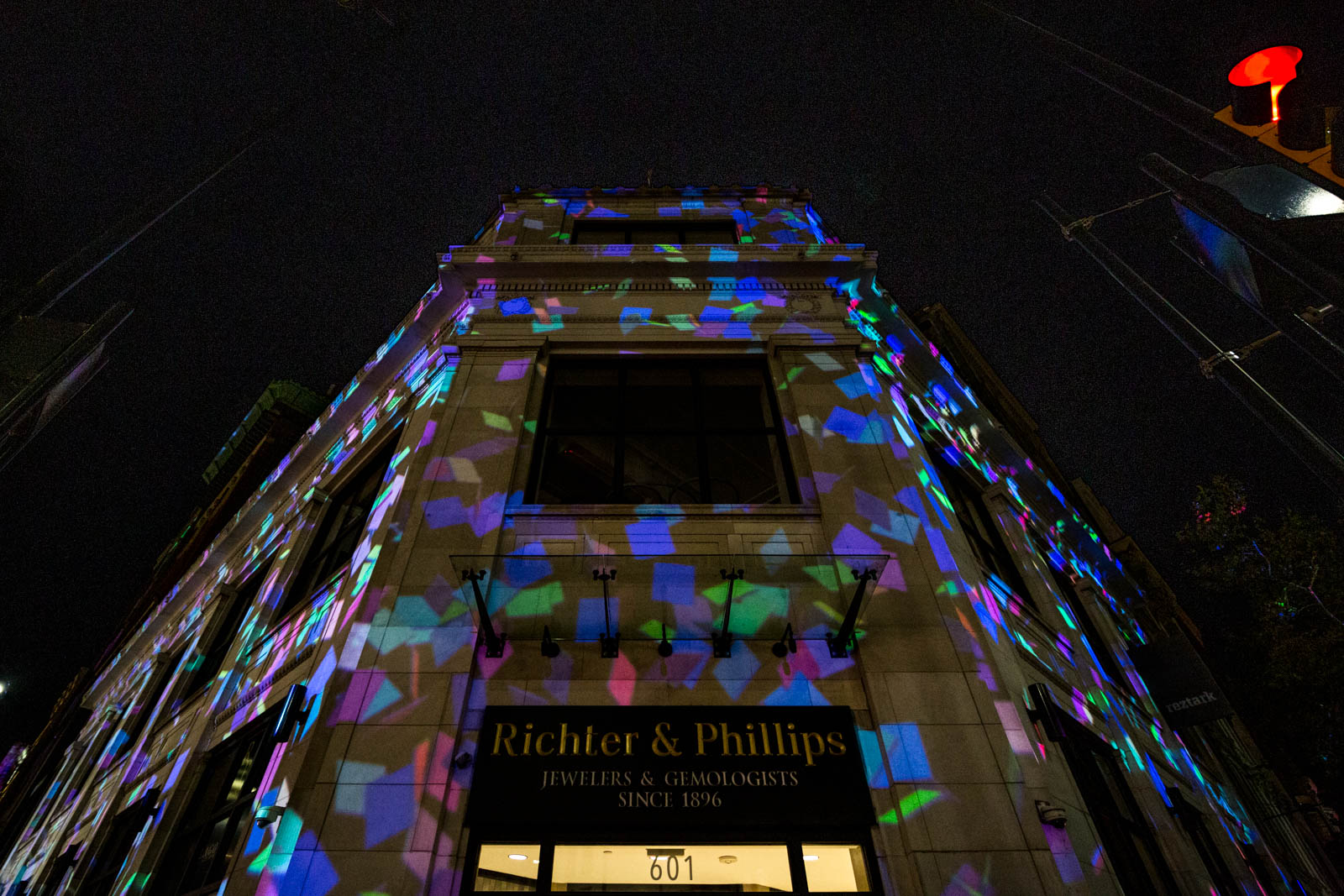PICTURED NEIGHBORHOOD: Downtown / The building at the corner of 6th and Main Streets was lit up for BLINK this time. / Image: Catherine Viox // Published: 10.12.19