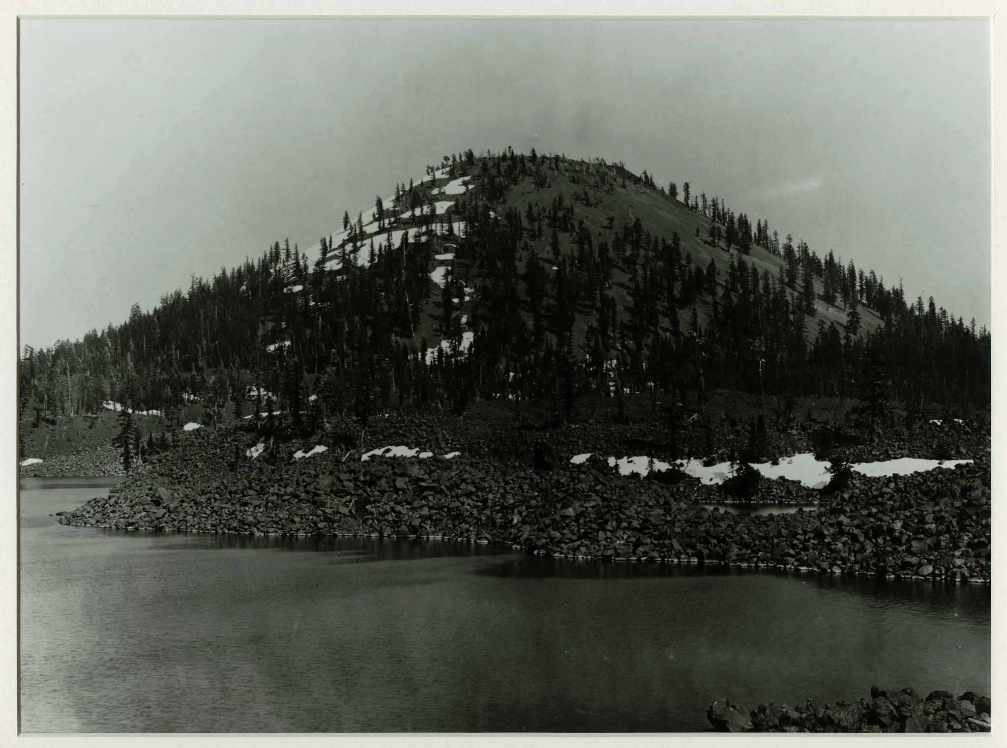 Wizard Island in Crater Lake. Photographed by J.S. Diller in the 1890s or 1901 during the USGS survey of the Crater Lake area.   Credit: Courtesy CRLA Museum & Archive Collections