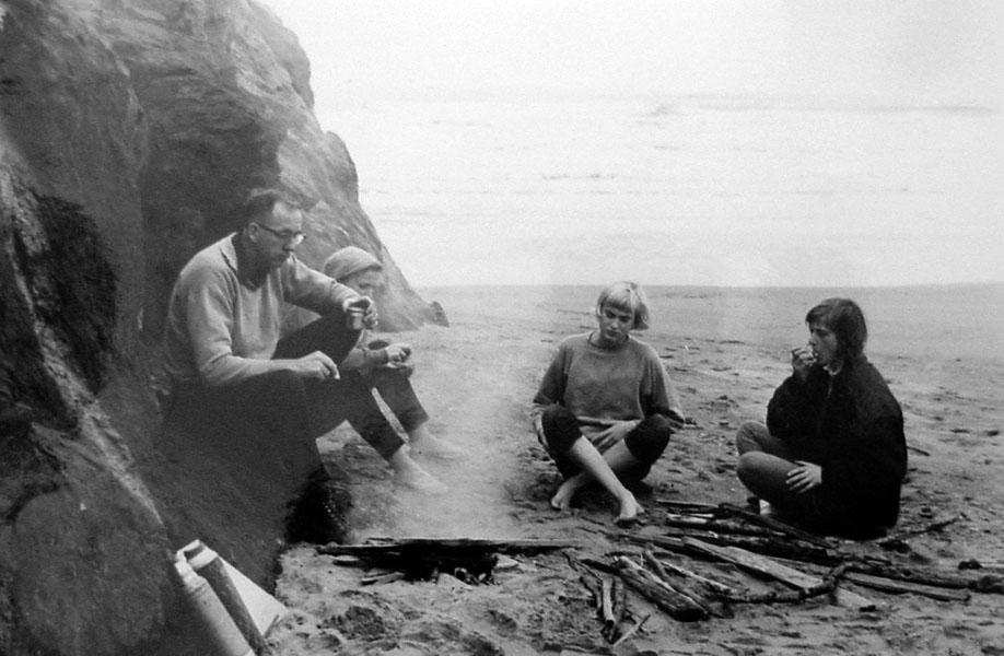"Bob and Pat Straub have a picnic lunch with daughters Patty and Peg near Proposal Rock on the Oregon coast. The caption in the scrapbook reads ""Lunch in no wind and rain."" (Western Oregon University Archives - Robert W. Straub Collection/Used with permission)"