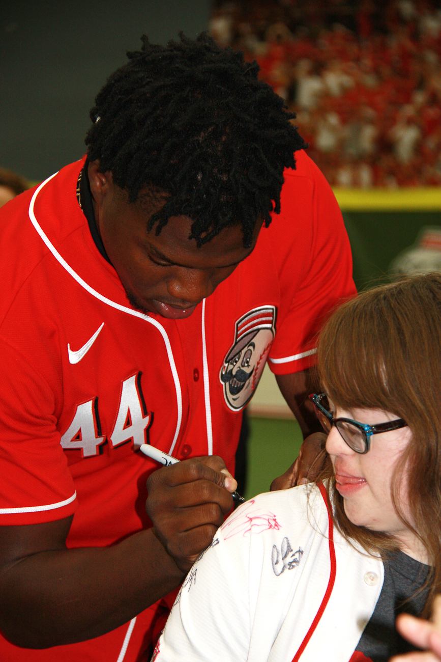 Aristides Aquino, right fielder #44, autographs a shirt