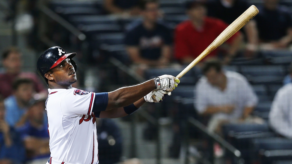 Atlanta Braves left fielder Justin Upton (8) follows through with a home run in the eighth inning of a baseball game against Milwaukee Brewers, Monday, May 19, 2014 in Atlanta. Atlanta won 9-3. (AP Photo/John Bazemore)