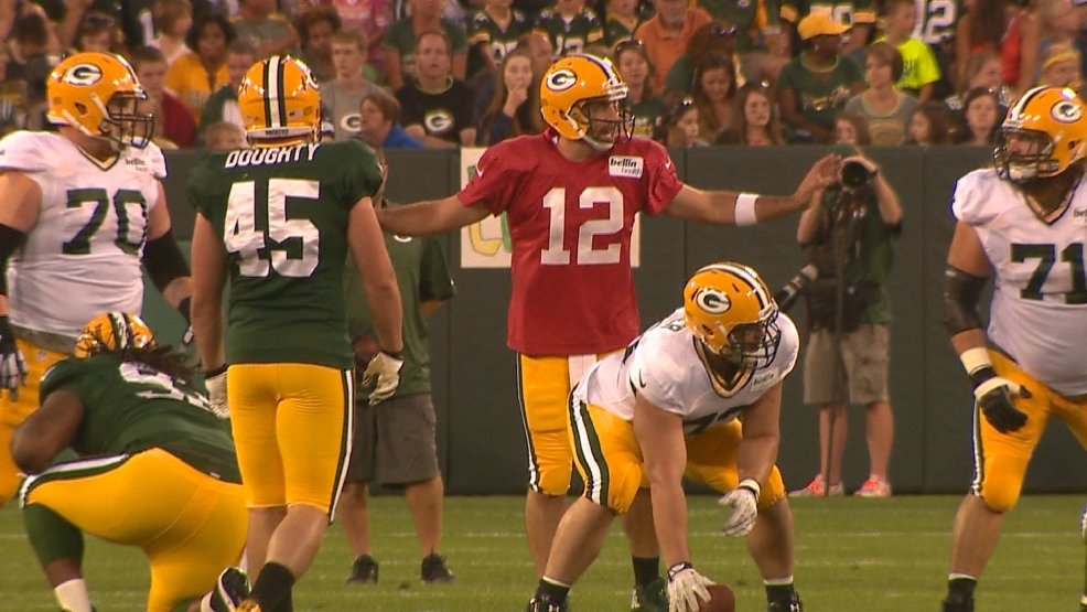 Aaron Rodgers calls a play at the line of scrimmage during the 2014 family night practice.