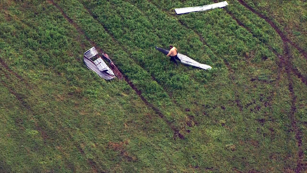 A man works to stack debris in a field blown there from a possible tornado in Lacomb, Oregon Tuesday, Sept. 19, 2017. (Photo: Chopper 2/KATU News)