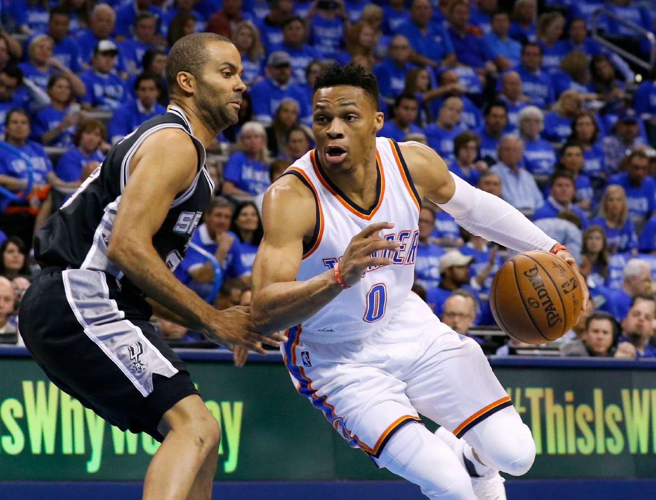 Oklahoma City Thunder guard Russell Westbrook (0) drives around San Antonio Spurs guard Tony Parker, left, in the first quarter of Game 6 of a second-round NBA basketball playoff series in Oklahoma City, Thursday, May 12, 2016. (AP Photo/Alonzo Adams)