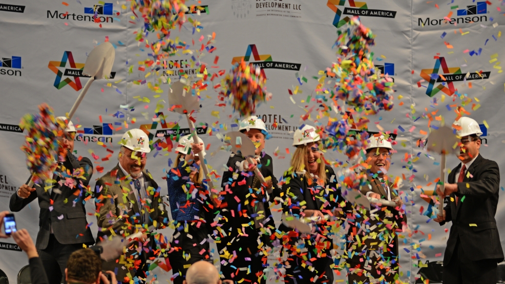 Dignitaries shovel confetti during the groundbreaking ceremony for Mall of America's phase II, which will include a hotel, offices and more retail space, Tuesday, March 18, 2014, at the MOA Rotunda in Bloomington, Minn. (AP Photo/The Star Tribune, Richard Sennott)