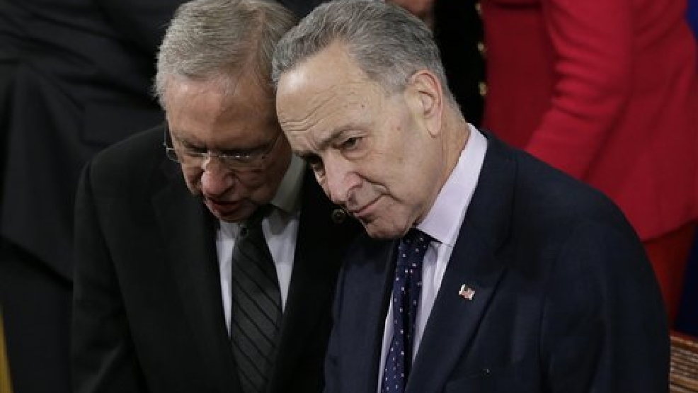 Senate Majority Leader Harry Reid of Nev., left, talks with Sen. Charles Schumer, D-N.Y., before President Barack Obama's State of the Union address on Capitol Hill in Washington, Tuesday Jan. 28, 2014. (AP Photo/J. Scott Applewhite)