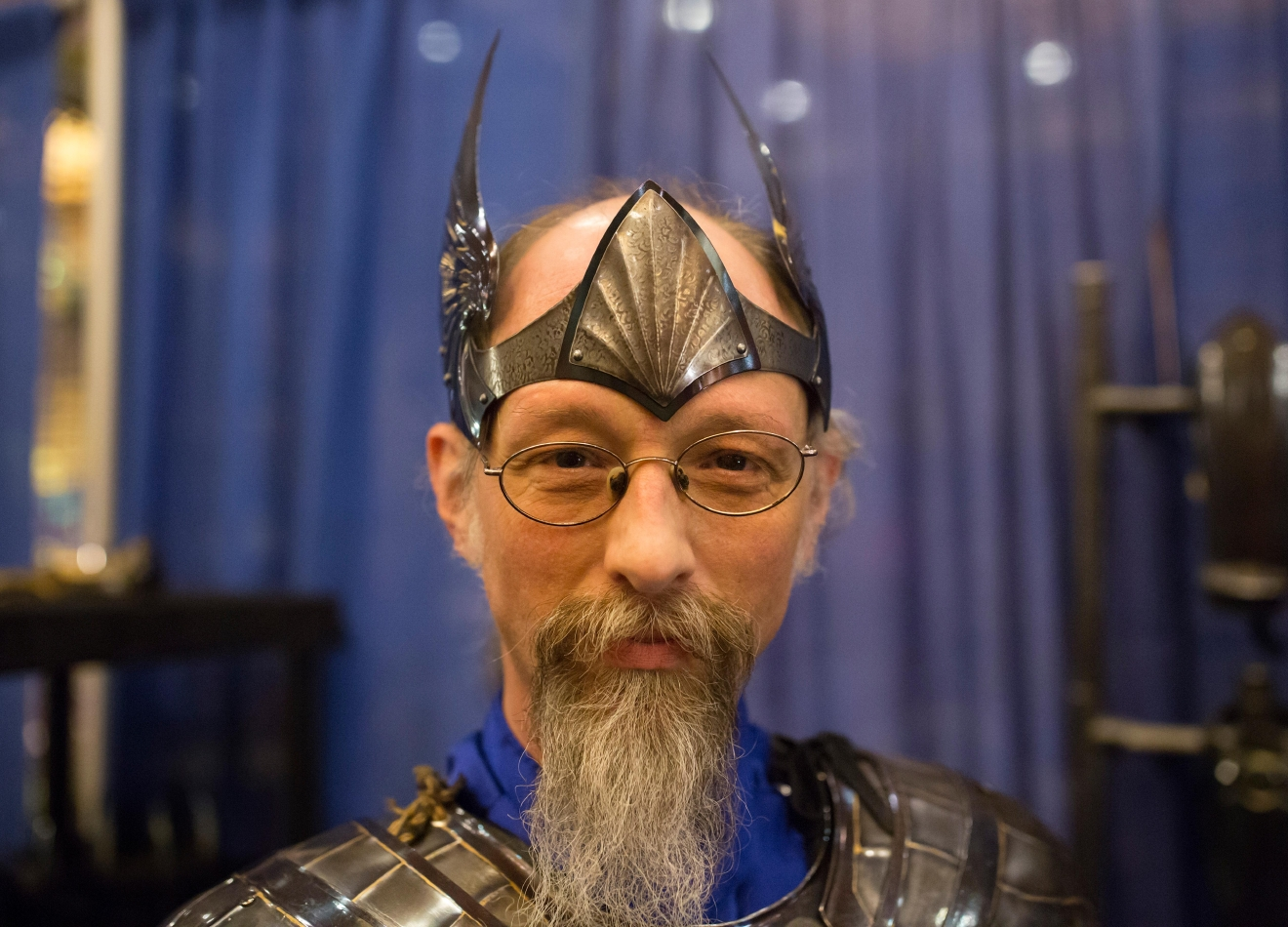 Aaron Parker of Sinister Metal Works tries on his most popular handmade crown that he crafts out of 20 gauge metal at Mythicworlds Convention and Masquerades. (Sy Bean / Seattle Refined)