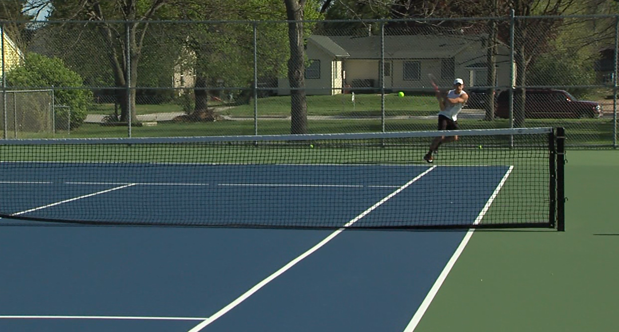 A member of the men's Hastings College tennis team returns a backhand baseline shot at a practice, May 1, 2017 (NTV News)