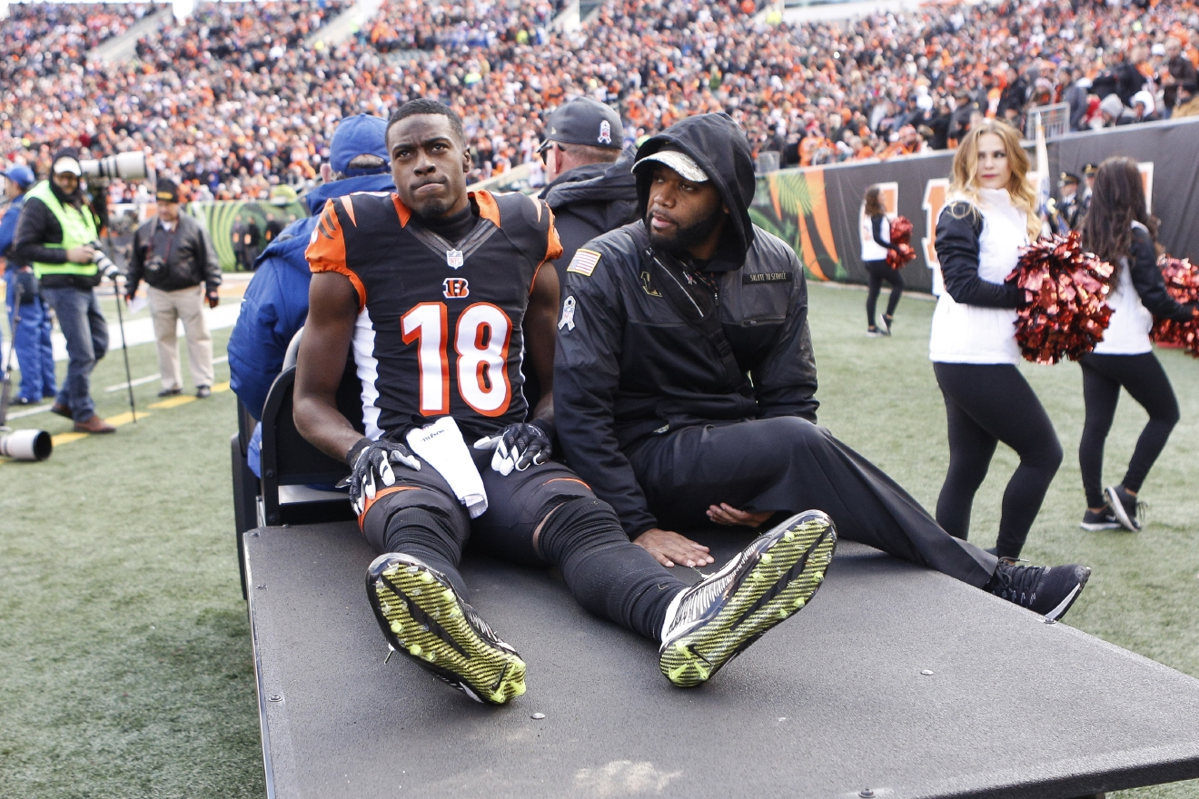 Cincinnati Bengals wide receiver A.J. Green (18) is carted off the field after an apparent injury in the first half of an NFL football game against the Buffalo Bills, Sunday, Nov. 20, 2016, in Cincinnati. (AP Photo/Frank Victores)