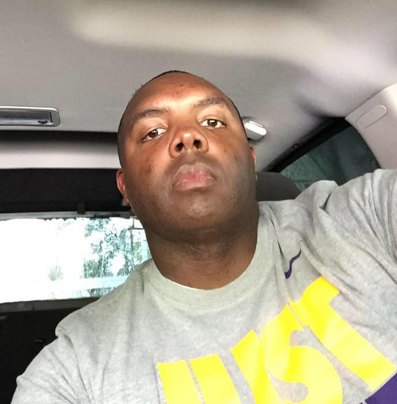 This undated photo taken from Baton Rouge Police Officer Montrell Jackson's Facebook page shows Jackson in a vehicle. Jackson and two other Baton Rouge law enforcement officers investigating a report of a man with an assault rifle were killed Sunday, July 17, 2016, less than two weeks after a black man was fatally shot by police here in a confrontation that sparked nightly protests that reverberated nationwide. (Facebook via AP)