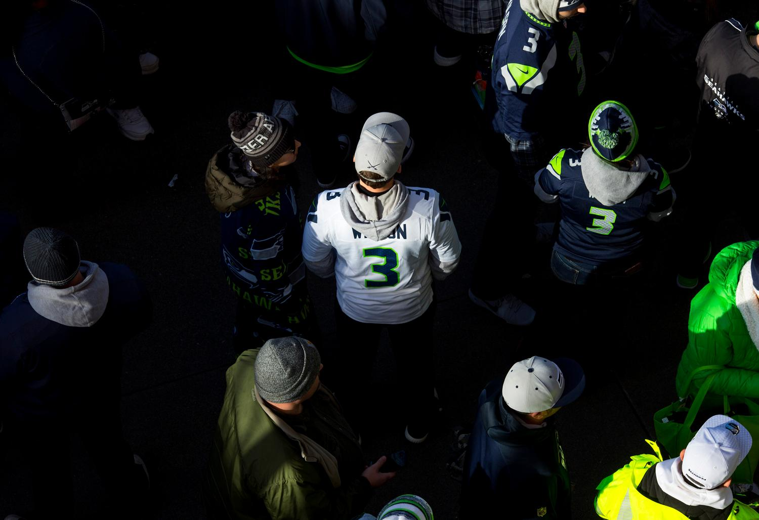 The sun came down on Seattle Seahawks fans as the hawks compete against the Arizona Cardinals during the last regular season game on New Year's Eve day at CenturyLink Field in Seattle. The Cardinals lead the half, 20-7. (Sy Bean / Seattle Refined)
