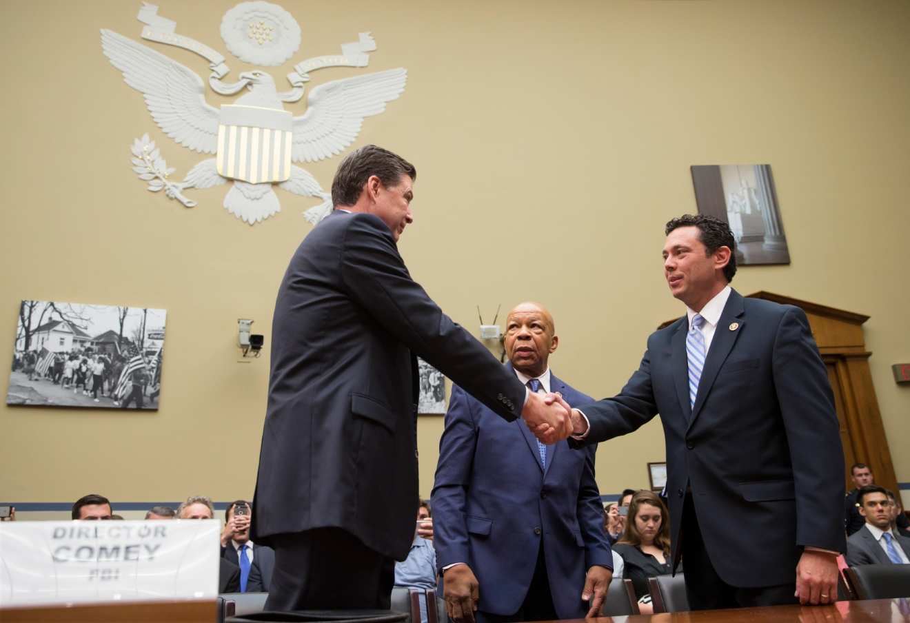 House Oversight and Government Reform Committee Chairman Rep. Jason Chaffetz, R-Utah, right, accompanied by the committee's ranking member Rep. Elijah Cummings, D-Md., center, welcome FBI Director James Comey, on Capitol Hill in Washington, Thursday, July 7, 2016, prior to Comey testifying before the committee's hearing  to explain the agency's recommendation to not prosecute Democratic presidential candidate Hillary Clinton over her private email setup as secretary of state. (AP Photo/J. Scott Applewhite)