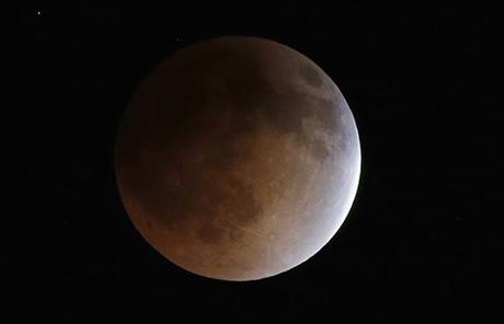 The moon turns an orange hue during a total lunar eclipse on April 15, 2014, in the sky above Phoenix. On April 29, the Southern Hemisphere will be treated to a type of solar eclipse. In all, 4 eclipses will occur this year, 2 lunar and 2 solar.