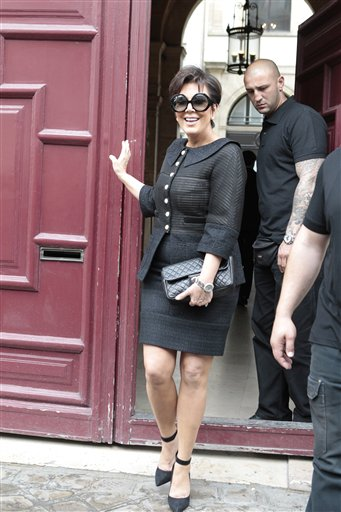 Kris Jenner, mother of Kim Kardashian, leave Kanye West's Paris apartment, Tuesday, May 20, 2014.