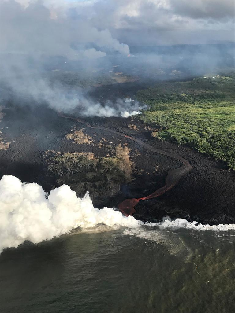 This Wednesday, May 23, 2018, photo provided by the U.S. Geological Survey, the active fissure complex in Kilauea Volcano's lower East Rift Zone near Pahoa, Hawaii. The volcano produces methane when hot lava buries and burns plants and trees. Scientists say the methane can seep through cracks several feet away from the lava. ( U.S. Geological Survey via AP)