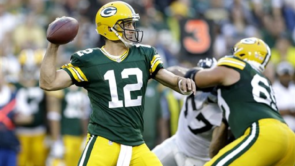 Green Bay Packers quarterback Aaron Rodgers (12) throws a pass against the Oakland Raiders  during the first quarter of an NFL preseason football game Friday, Aug. 22, 2014, in Green Bay, Wis. (AP Photo/Tom Lynn)