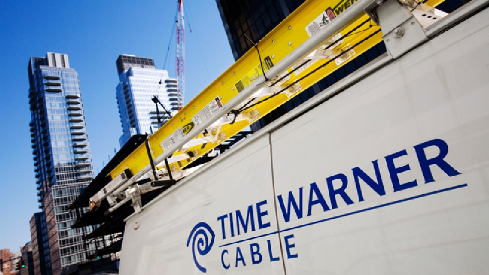 In this Feb. 2, 2009 file photo, a Time Warner Cable truck is parked in New York. (AP Photo/Mark Lennihan, File)