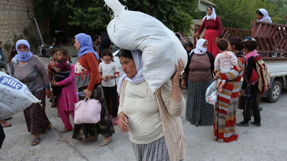 Displaced Iraqis from the Yazidi community arrive at the Mountains of Shikhan near Dahuk, 260 miles (430 kilometers) northwest of Baghdad Monday, Aug. 11, 2014. (AP Photo/ Khalid Mohammed)