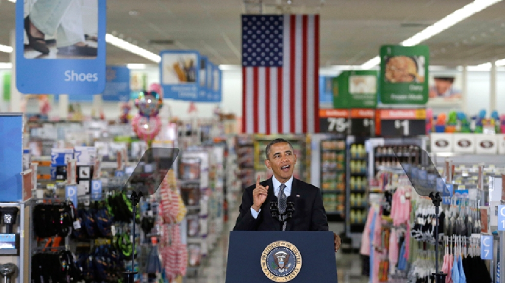 President Barack Obama speaks at a Wal-Mart store in Mountain View, Calif., Friday, May 9, 2014. Obama announced new steps by companies, local governments and his own administration to deploy solar technology, showcasing steps to combat climate change that don't require consent from a disinclined Congress. (AP Photo/Jeff Chiu)