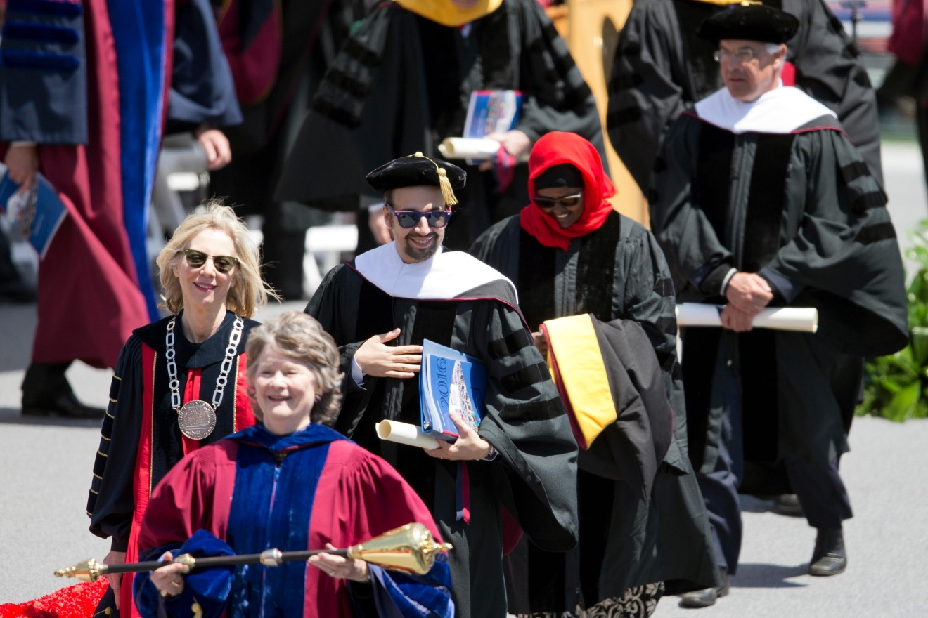 "Lin-Manuel Miranda, creator of the Broadway musical ""Hamilton,"" center left, walks with faculty from the University of Pennsylvania commencement ceremony, Monday, May 16, 2016, in Philadelphia. Miranda spoke Monday at the University of Pennsylvania commencement. (AP Photo/Matt Rourke)"