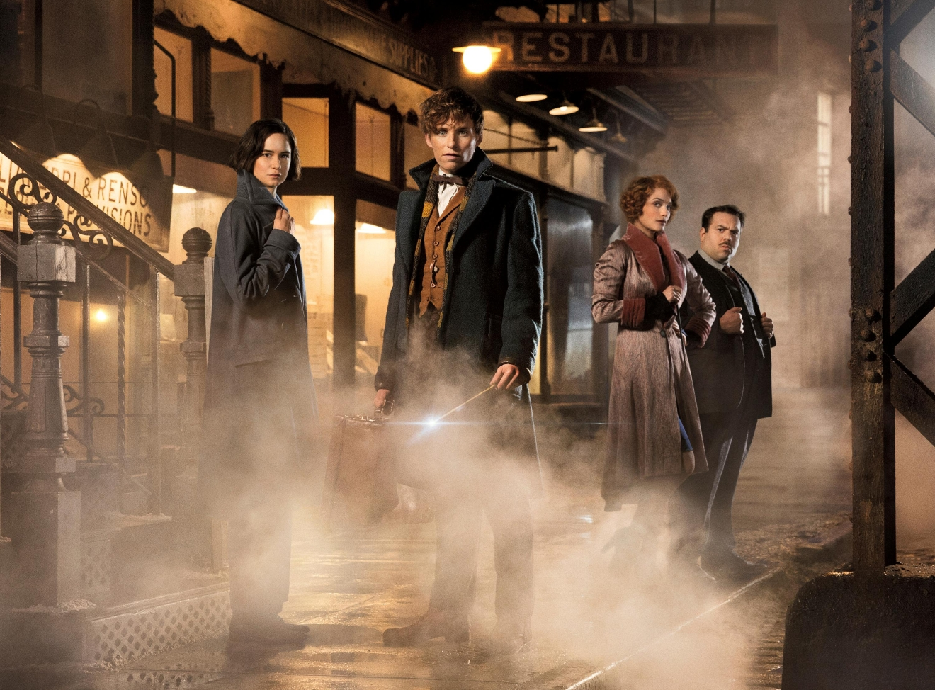 "This image released by Warner Bros. Pictures shows, from left, Katherine Waterston, Eddie Redmayne, Alison Sudol and Dan Folger in a scene from ""Fantastic Beasts and Where to Find Them."" (Jaap Buitendijk/Warner Bros. Pictures via AP)"