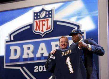 Tackle D.J. Fluker from Alabama stands with NFL commissioner Roger Goodell after being selected 11th overall by the San Diego Chargers in the first round of the NFL football draft, Thursday night.
