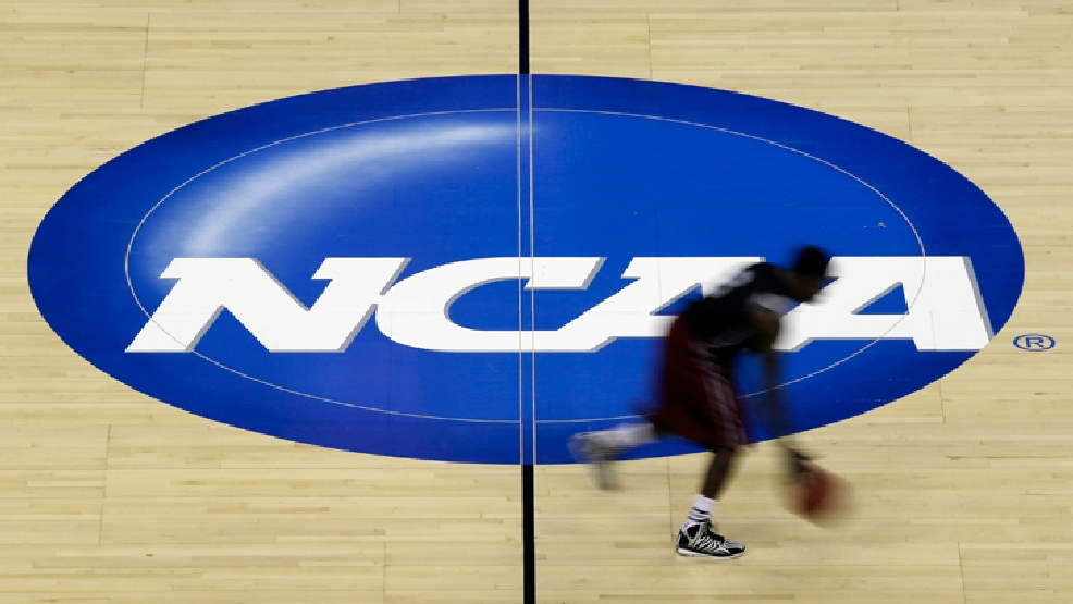 A Massachusetts player runs past mid court during practice at the NCAA college basketball tournament in Raleigh, N.C., Thursday, March 20, 2014. Massachusetts plays Tennessee in a second-round game on Friday. (AP Photo/Gerry Broome)