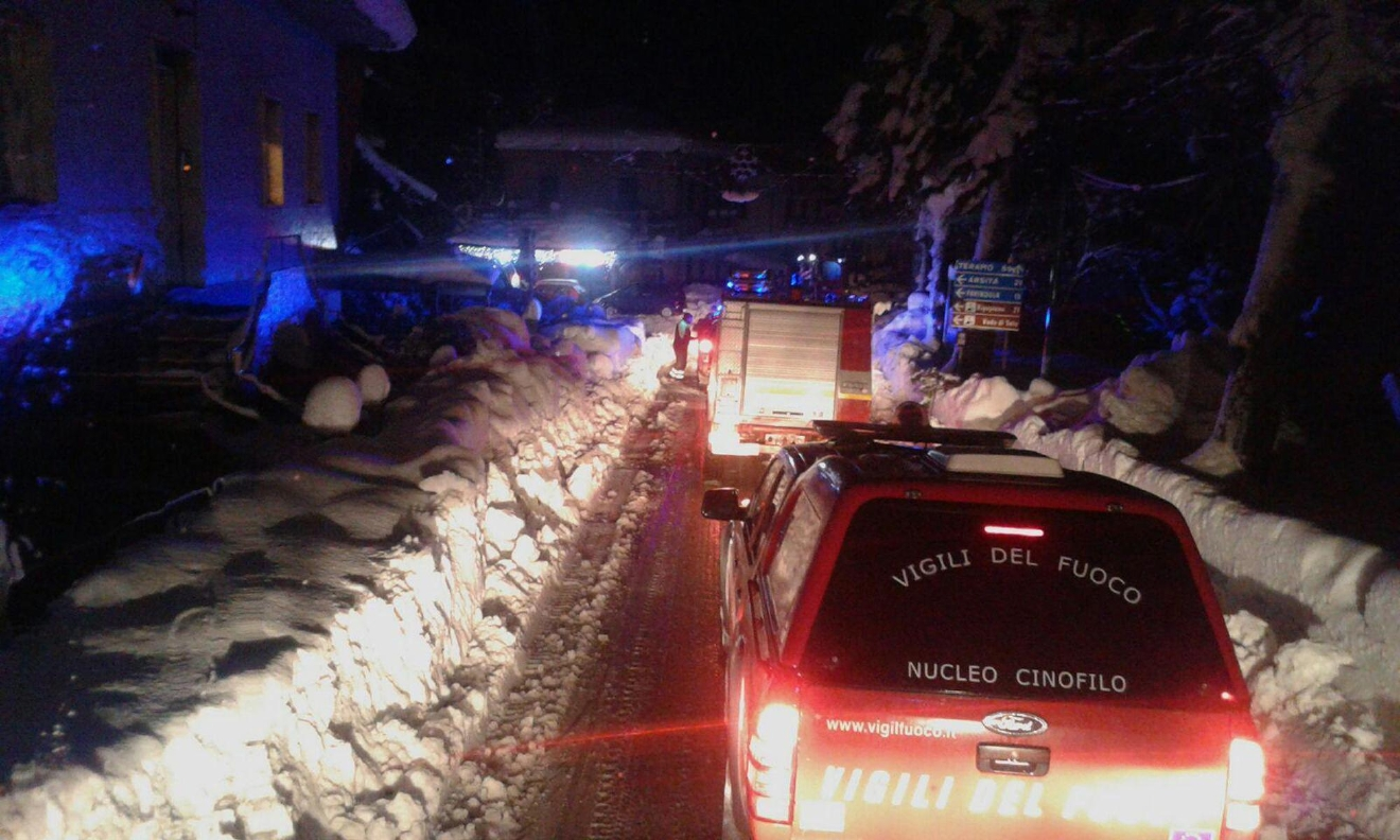 Firefighters vehicles make their way to the hotel hit by an avalanche in Farindola, Italy, early Thursday, Jan. 19, 2017. A hotel in the mountainous region hit again by quakes has been covered by an avalanche, with reports of dead. Italian media say the avalanche covered the three-story hotel in the central region of Abruzzo, on Wednesday evening. (Italian Firefighters via AP)