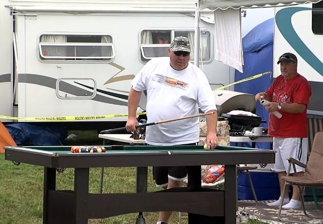 A NASCAR fan plays pool at his tailgate at Talladega Friday, May 3, 2013.