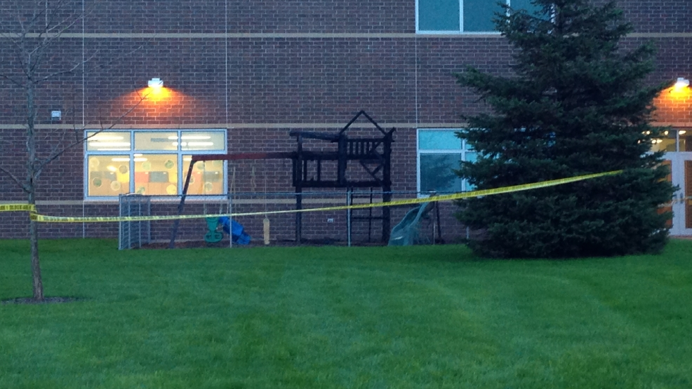 A playground outside New London High School is damaged by fire, May 20, 2014. (WLUK/Pauleen Le)