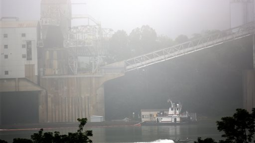 Cleanup is underway near the Beckjord Power Plant, in New Richmond, Ohio, after an estimated 5,000 to 8,000 gallons of fuel oil spilled into the Ohio River, closing about a 15-mile section of the waterway southeast of Cincinnati, on Tuesday, Aug. 19, 2014. (AP Photo/The Cincinnati Enquirer, Amanda Rossmann)