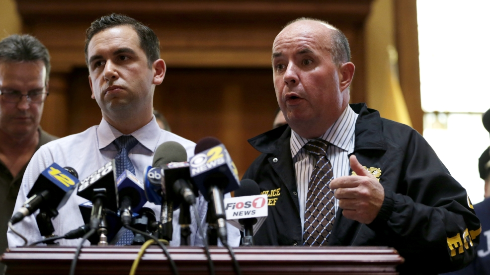 Jersey City Police Chief Robert Cowan, right, talks while standing next to Mayor Steven Fulop during a news conference talking about an early morning shooting which lead to a suspect and a Jersey City Police Department officer killed, Sunday, July 13, 2014, in Jersey City, N.J. Officer Melvin Santiago was shot in the head while still in his police vehicle as he and his partner responded to an armed robbery call at about 4.a.m., Fulop said. The Mayor said officers responding to the robbery call shot and killed the man who shot Santiago. (AP Photo/Julio Cortez)