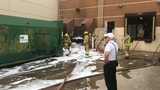 Suspect detained after setting dumpster fire at department store