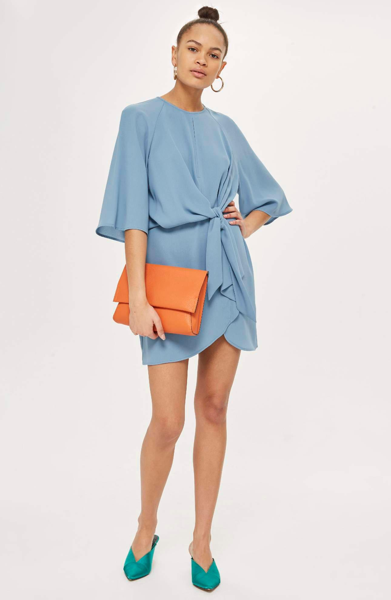 Flowy drape is the design aesthetic of this raglan-sleeve dress with a tulip-style skirt and panels that gather to knot at the front waist.<p>$80.00 at Nordstrom. (Image: Nordstrom){&nbsp;}</p>